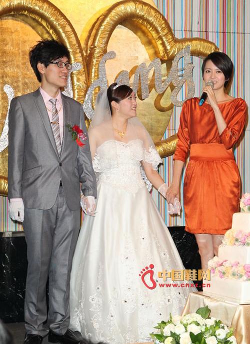 梁咏琪今身穿橘红色礼服搭配高跟鞋
